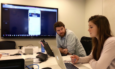 Two people are featured in an office setting, conducting a usability test.